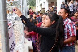 Students Placing Locks on the Gates with Their Families During Commitment Ceremony